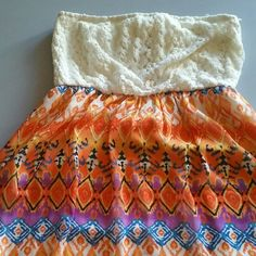 Dress crochet/mini strapless/opening in back/L Large size  colorful crochet  mini sun dress that is perfect  to show off your back! Theres a peek a boo opening in the back. Preowned. Worn x 1. She doesnt fit in ot anymore. CUTE! Dresses Mini