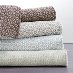 Test drive this rug in your space.Order a swatch by adding it to your cart.Tightly woven for durability and versatility, this woven wool area rug with a honeycomb pattern in shades of seafoam and ivory is perfect for any space, from the beach house to home, sweet home!