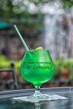 "Pat O'Brien's -- ""Rainstorm"" - 1 oz Vodka, ½ oz Malibu Rum, ½ oz Melon Liquor, top with ¼ oz Blue Curacao, 1 oz Pineapple Juice and 1 oz Sour Mix, Garnish with a lemon and cherry"