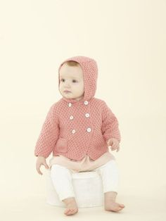 Baby hooded jacket with pockets knitting pattern in the First Sublime Evie pattern book - get it at LaughingHens.com
