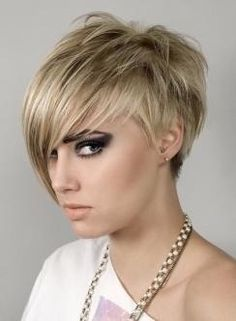 This edgy short cut is polished off with a smokey eye.