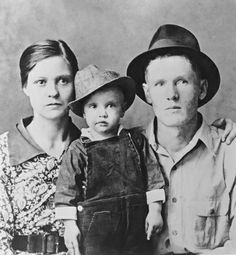 The Presley Family - A two-year-old Elvis Presley poses with his parents, Gladys and Vernon, in Tupelo, Mississippi in 1937