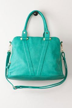 """Introducing our new favorite bag from Violet Ray – The Triple Zip Satchel! This vegan leather bag features plenty of space for any girl on the go. Finished with three large zipper compartments, three interior pockets, and an optional strap. Pair with your favorite top and some booties. Choose from gray or teal.<br><br>    - 14"""" width x 11"""" height x 7"""" depth <br>  - 7"""" handle drop<br>  - 46"""" adjustable strap<br>  - Imported<br>"""