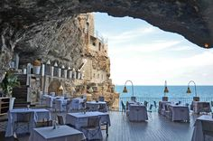 The dining area in the cave at the Grotta Palazzese. Photo by Giovanni Barnaba, flickr