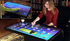 Putting the table into the tablet: Giant touchscreen furniture will play games, apps and control smart devices in your home