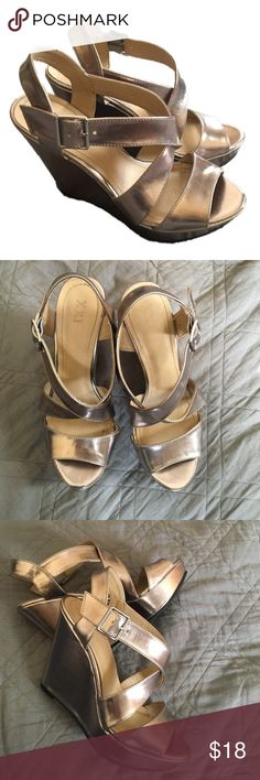 Champagne metallic wedge heels Excellent condition. Possibly worn once if ever. They seem to run on the narrower side. Color is sort of between silver and gold, like a champagne color. XXI Shoes Heels