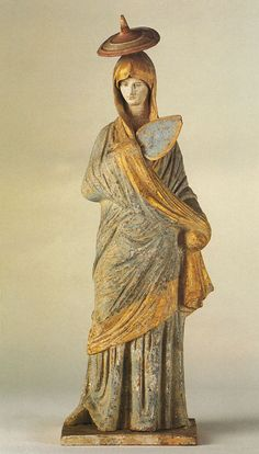 Young woman wearing a hat, with a fan Clay Ca. 320 BCE. Height 34 cm. > ancientrome.ru