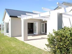 64 Bitou Glade - A beautiful family self-catering apartment, boasting stunning views of the ocean, situated on the border of Brackenridge in Plettenberg Bay. 64 Bitou Glade consists of three spacious bedrooms and three .
