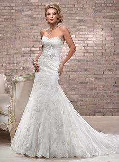 Alana - by Maggie Sottero  IN LOVE!  would be perfect if it buttoned in the back.