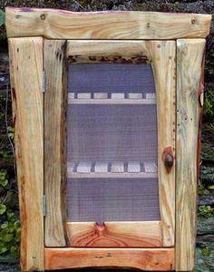 hella gorgeous pallet/found wood cabinet