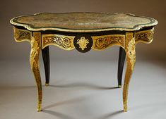 """NAPOLEON III 'BOULLE' INLAID, EBONIZED AND ORMOLU MOUNTED CENTER TABLE, French, late 19th century, featuring an oblong top with inlaid brass cutwork around a centralized pictorial, the serpentine apron, drawer and four tapering legs decorated in similar fashion, the legs ending in applied sabots. Dimensions: 30.5""""H x 29.5""""D x 51.75""""W."""