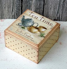 tea box................ I don't know which I like more, the art or what's in the box.