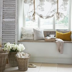 Beautiful Cottage Chic Window Seat Decor including the window treatment, baskets of flowers & shutter.
