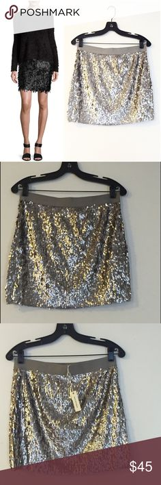 """Max Studio Metallic 🆕 Mini Skirt Cha-cha-cha. This Max Studio metallic mini skirt in silver is the perfect summertime skirt. Bare legs, cami top, and you're ready for lunch or dinner. - Elastic waistband  - Length 15.5"""" - Lined - Shell: 100% polyester; Lining: 65% polyester, 35% rayon - Hand wash cold Max Studio Skirts Mini"""