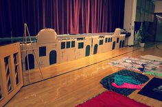 Bethlehem skyline along stage... blankets instead of tables and chairs