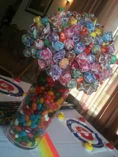 {tip: use a Styrofoam ball for the top half of the centerpiece & completely cover with lolly pops}