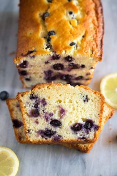 Lemon Blueberry Bread is made with Greek Yogurt, fresh or frozen blueberries, and a simple icing. This easy recipe can be enjoyed year round. Blueberry Banana Bread, Frozen Blueberry Recipes, Lemon Blueberry Pound Cake, Summer Dessert Recipes, Brunch Recipes, Lemon Yogurt, Frozen Blueberries, Sweet Bread, Snacks
