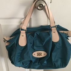 R R Turquoise Handbag Made in Spain New Brand new turquoise Nylon shoulder bag with the R R logo on the front inside pockets has two logos inside made in Spain 16 x 10 beige shoulder straps. Does not come with longer strap brand new This is not no cheap bag R R Bags Shoulder Bags