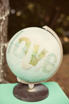 f we dont' spell love, we could do little hearts all around the world... travel theme wedding globe