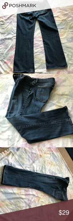Lucky Brand Regular Jeans 14/32 preowned These preowned jeans are in good condition- there is a little worn looking at bottom of jean..front rise is 9 1/2 - waist is 32 - inseam is 30 hips are 38. Lucky Brand Jeans Straight Leg