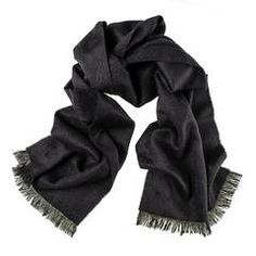 Classic and reliably soft, this black scarf (100% Cashmere) with thick fringing is a stable for any cashmere collection. Made in England from the finest Cashmere. Free UK Delivery