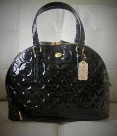 This Glossy Patent Leather Elegant Bag with Gold Hardware drips with luxury. The Iconic Coach Does it Again with the Peyton Op Art Embossed Patent Cora Domed Satchel.  You Cannot Find a Satchel Designed Better Than This One! For Fine Craftsmanship and Style Most Women Turn to Coach who  Delivers ...