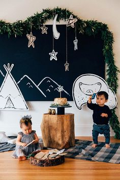 Love this dreamy outdoor photo backdrop for a camping themed birthday party or as an everyday backdrop in your home.