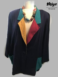 "Beautiful Vintage Navy Blue Blazer with color blocking along the color. The colors are turquoise, pink, and mustard yellow. Tagged size is 22.    Looks great if worn oversized. Best fit L-2X, depending on fit preference.     Bust - 27"" pit to pit      