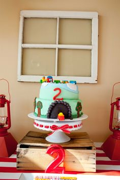 Darling CAKE at this Red + Blue Choo Choo Train themed birthday party via Kara's Party Ideas KarasPartyIdeas.com. #TrainParty #Thomas #ChooChoo #TrainCake