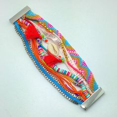 Love this boho multi-strand bracelet from www.PearlsAndRocks.com , it's so colorful and beachy, hipanema style.