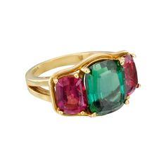 Verdura Green Tourmaline & Rubellite Three-Stone Ring in 18k yellow gold. Green tourmaline weighing 5.04 carats and two rubellites weighing 2.67 total carats