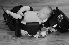 Police baby www.jmbphotographysc.com @Denise Daniel Kronenberger - We should do this with Daddy's belt and the kids sitting in it :)