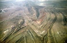 "liesegangpoisoning:    Sheep Mountain anticline - Wyoming  All kindsa goodies up in there! Belemnites, pentacrinus, gastroliths, ""devil's toenails""… geologist/paleontologist heaven."