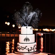 Today's cake is a flashback to the Roaring Twenties, complete with flapper feathers and a drop chandelier #roaring20s #cake