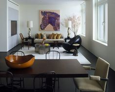 Luxe living + dining combo. Rug under living room, lamps beside the couch.