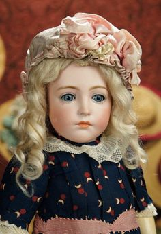 """18"""" Very Rare and Beautiful German Bisque Character, 111, by Simon and Halbig~~~wearing lovely antique dress, bonnet, undergarments, leather shoes. Condition: generally excellent. Marks: 111. Comments: Simon and Halbig, circa 1910. Value Points: very beautiful model of older child with pensive expression, enhanced by finest quality of bisque and painting, original body and body finish."""