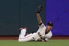 Gregor Blanco #7 of the San Francisco Giants makes a diving catch in left field in the third inning during Game One of the Major League Baseball World Series at AT & T Park on October 24, 2012