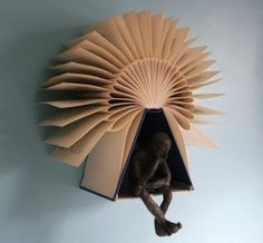 Amazing photos of Folded Book Art.  Not instructions, just photos and links to buy.