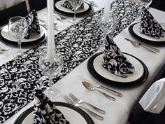 Simple elegance! Add a splash of color in the napkins and centerpieces