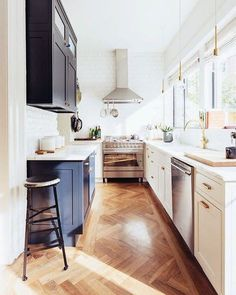 From the herringbone floors to the contrasting cabinets with sleek brass hardware, this Brooklyn kitchen is #goals...all of them! [Photo: Christopher Sturman]