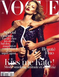 Vogue - seriously? Magazine cover with men prepped to rip off her clothes. Why?