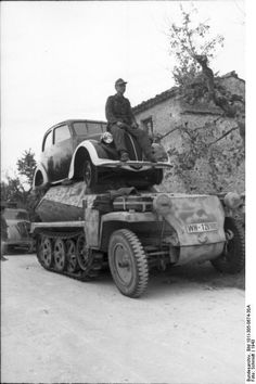 Schützenpanzer  with the first Wolks wagen Beetle. Italy.1943