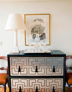 Love the nailhead trim. Could do this on Ikea expedit?