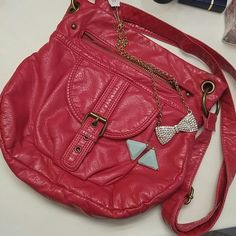 Hot Pink Crossbody Purse Soft faux leather in HOT PINK.  One zippered pocket outside and one zippered pocket inside only with two open pockets. Bueno Bags Crossbody Bags
