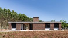 JM House / Troyano Arquitetura Completed in 2018 in Brazil. Images by Marcelo Donadussi. This single-family house is located in a generous allotment in General Câmara an inner town in the southern Brazilian state of Rio Grande do Sul. Outdoor Areas, Outdoor Structures, Car Shelter, Brick Yard, Concrete Casting, Load Bearing Wall, Solid Brick, Brick Construction, Rio Grande Do Sul