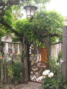 laser cut front gate with log arbor