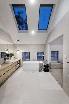 #masterensuite #masterbath #bathroomgoals #skylight #freestandingtub #pendantlight #doublevanity #floatingvanity