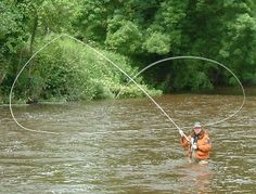 "Salmon fishing -- I think he's saying, ""I heart you""  with his Spey rod."