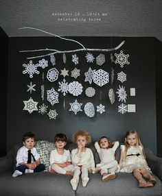 10 Times Paper Snowflake Decorations Actually Looked Pretty Fancy. Lila Was Here hung snowflakes from a painted tree branch. Noel Christmas, Christmas And New Year, Winter Christmas, Winter Holidays, All Things Christmas, Modern Christmas, How To Decorate For Christmas, Minimalist Christmas Tree, Christmas Snowflakes
