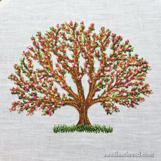 Hand embroidered tree with blossoms in simple stitches
